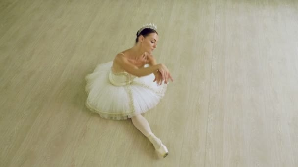 Classical ballet. Top view of ballerina dancing in pointe shoes in dance studio. 4K