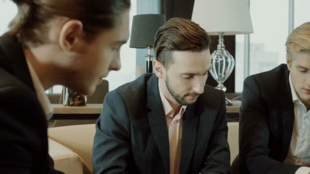 Close-up panoramic shot of businessmen discussing a deal at business meeting in the modern restaurant. 4K