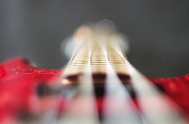 Close-up bass guitar strings with gray background