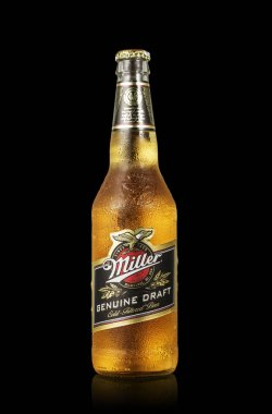 Editorial photo of Miller Genue Draft Beer bottle isolated on black. Path include