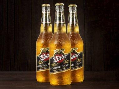 Editorial photo of Miller Genue Draft Beer bottles on dark wooden background
