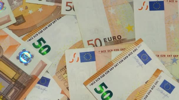 euros cash are flying and falling. Earnings, salary, deposit or credit concept, fifty 50 euro banknotes.