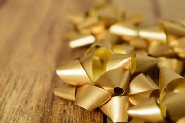 Beige bows on wooden background