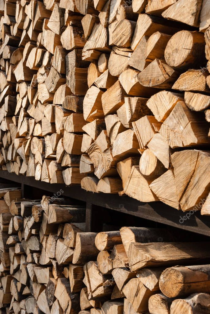 Stack of wood. Harvesting firewood for the winter.