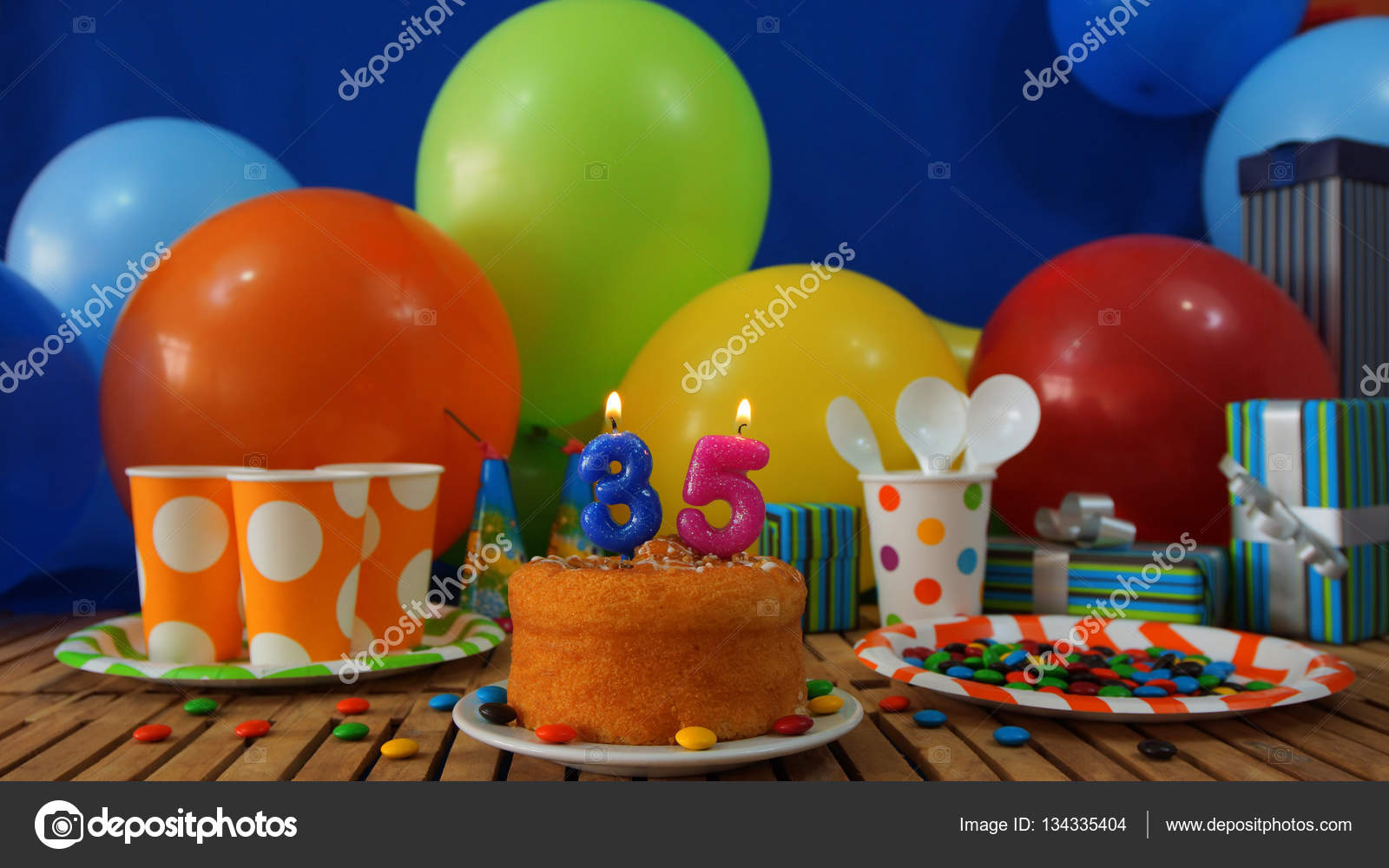birthday cake on rustic wooden table with background of colorful