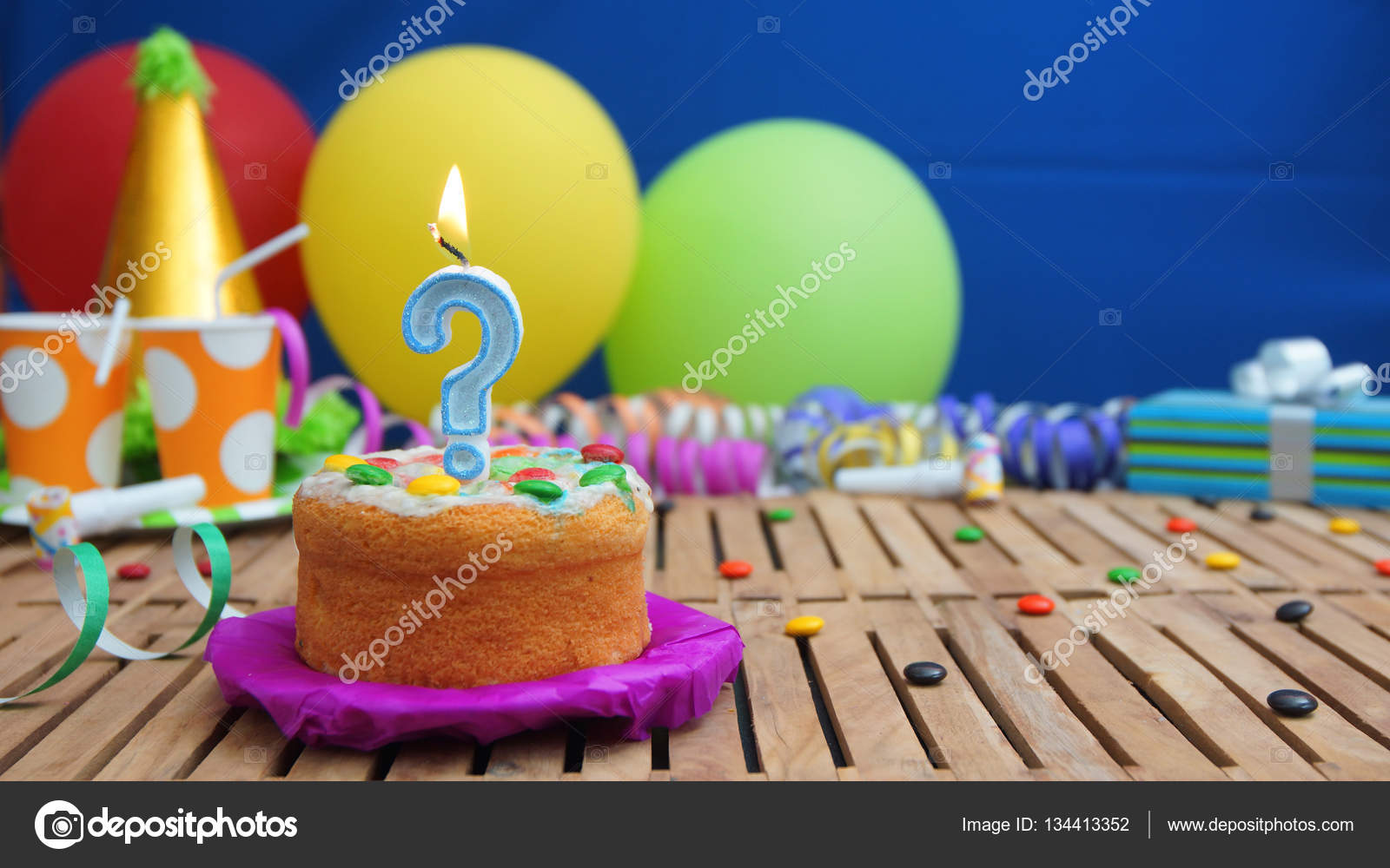 Birthday Cake With Candle In The Shape Of A Question Mark On Rustic
