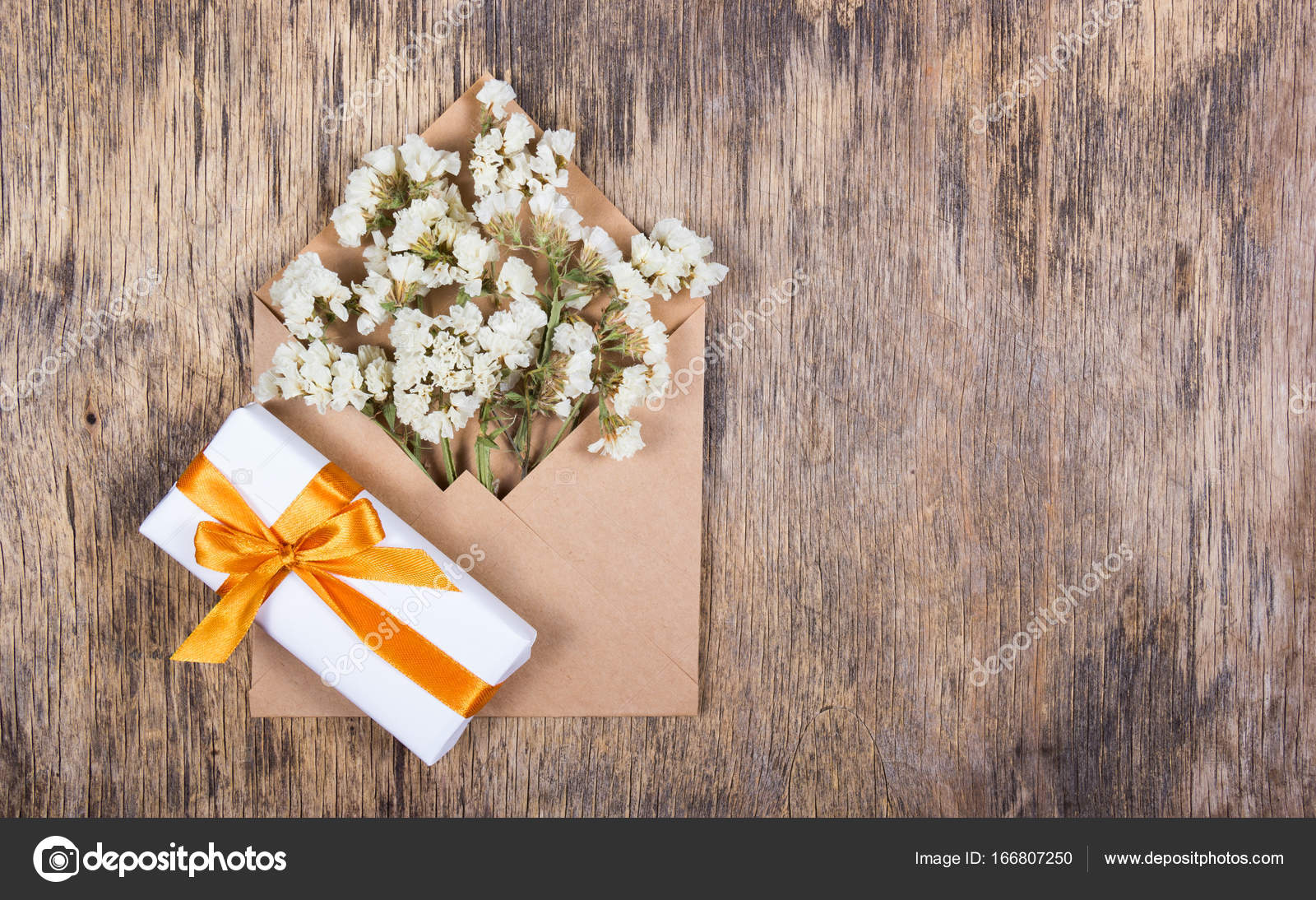 White Dried Flowers In A Paper Envelope And A Box With A Gift With A