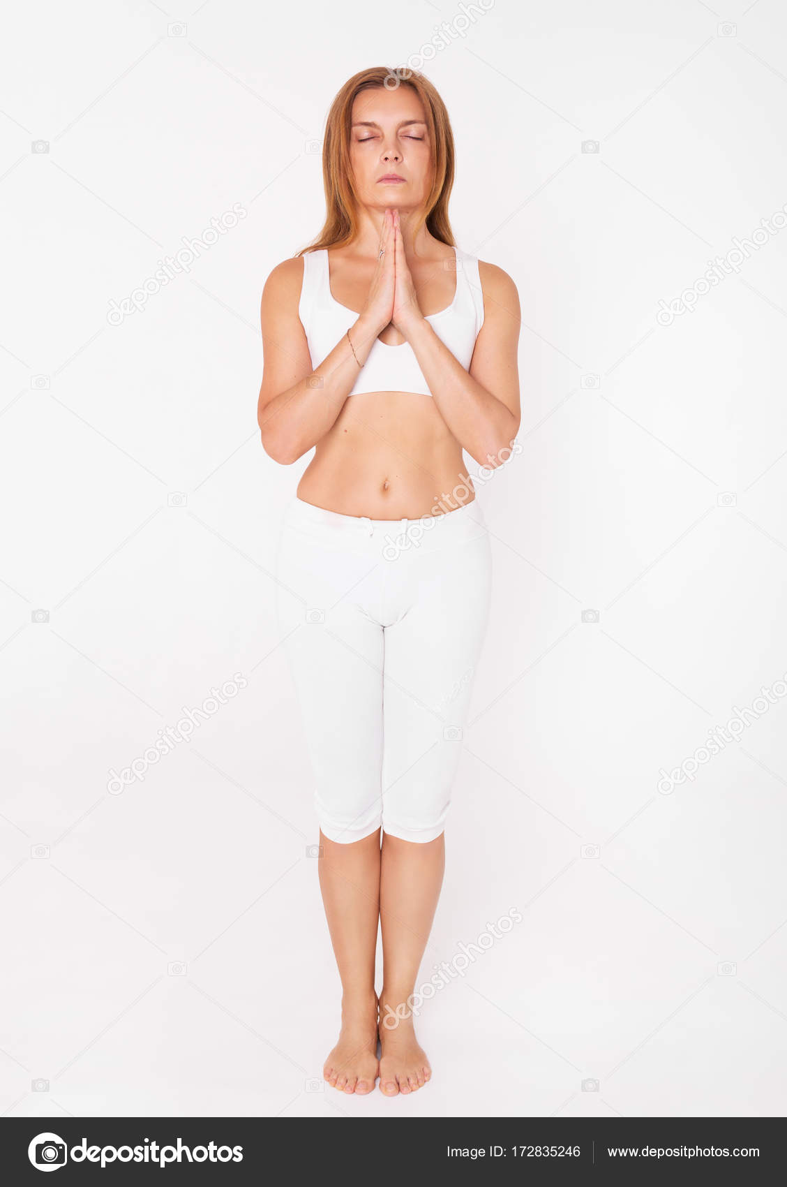 Adult Woman Doing Yoga Woman Standing Namaste Yoga Pose On A White