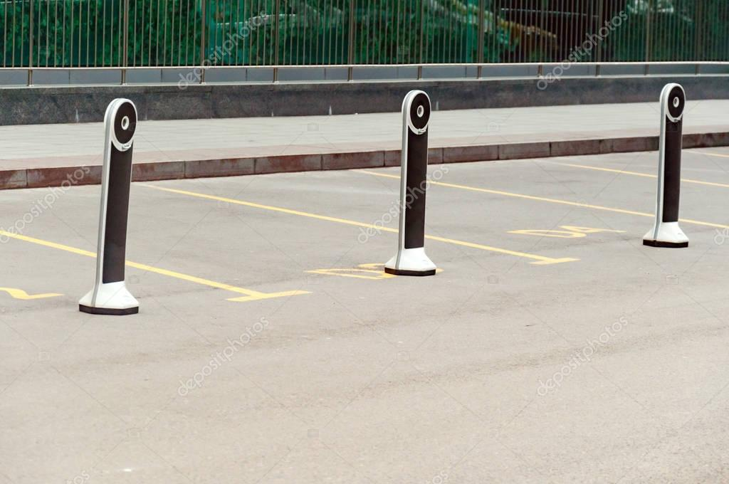 Columns designating parking spaces for important people. VIP