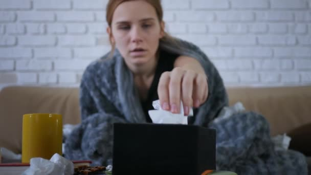 Portrait young attractive woman coughs into napkins cold autumn day flu season disease fever grippe health illness infection influenza migraine sickness. Close up.