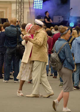 Elderly couple dancing.