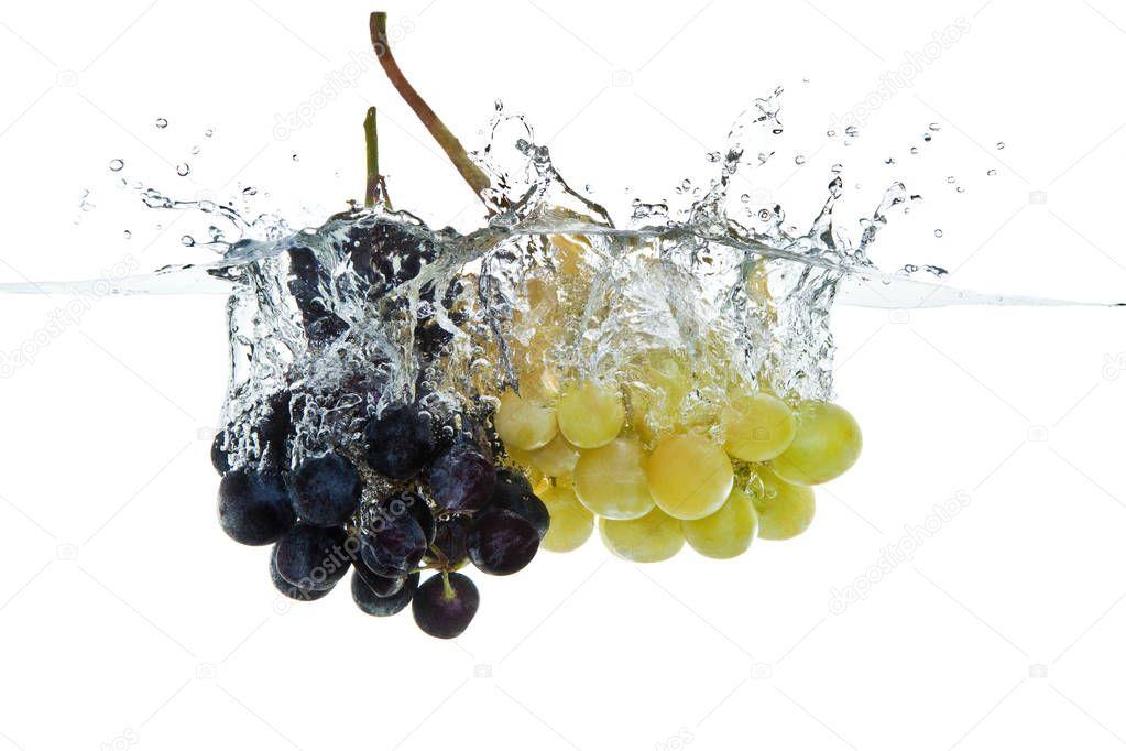 grapes fruits making splash in water