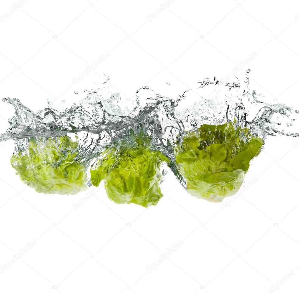 green salad vegetables making splash in water