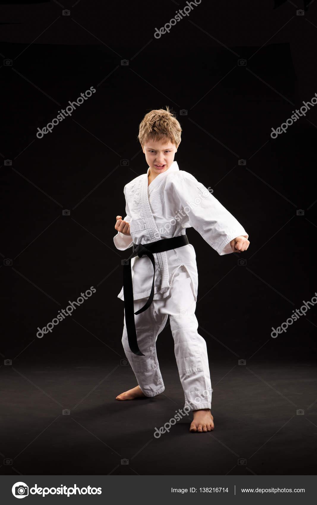 black belt karate blond kid isolated on black � stock