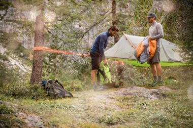men preparing hanging tent camping near forest woods