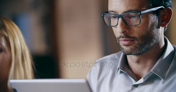 Man using tablet and eyeglasses.Corporate business team work office meeting.Three caucasian businessman and businesswoman people group talking strategy together.Collaboration,growing,success.4k video