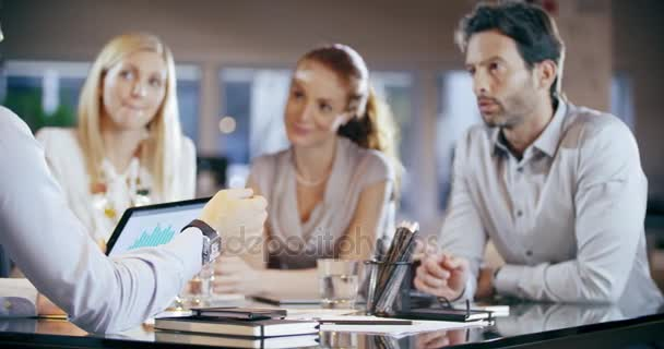 Corporate business team work office meeting.Four caucasian businessman and businesswoman people group talking strategy together.Collaboration,growing,success concept using tablet and chart. 4k video
