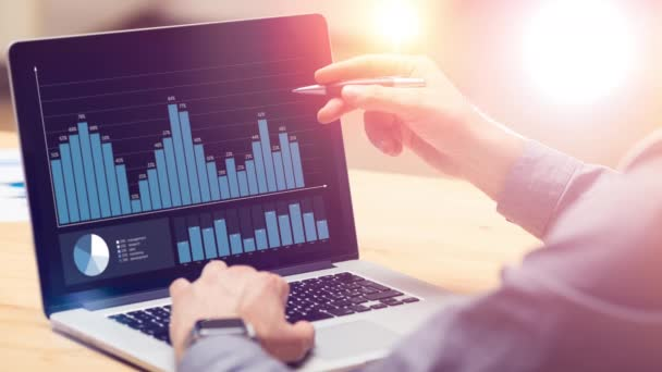 Businessman working on global financial trading growth analysis strategy using laptop.Modern business innovation investment concept.Virtual graph and chart data interface.4k loop cinemagraph video