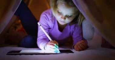 Child Blonde Caucasian Girl Digital Coloring With Tablet App Under Bed Blanket At Night Modern