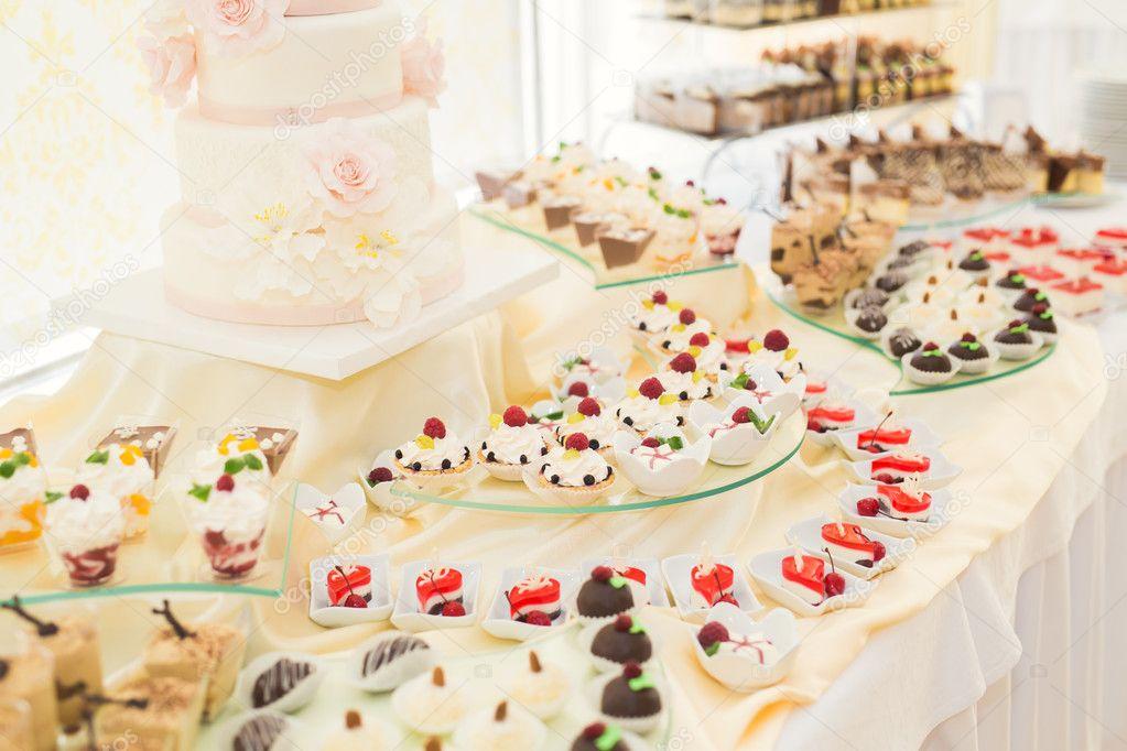 Delicious Wedding Reception Candy Bar Dessert Table Stock Photo 125597240