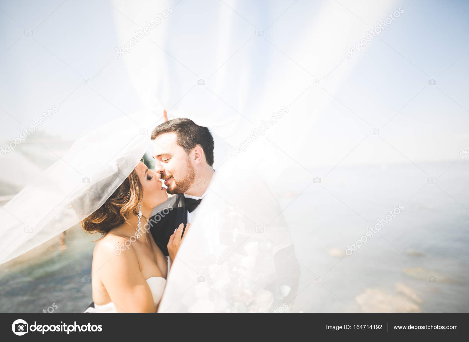 Happy And Romantic Scene Of Just Married Young Wedding Couple Posing