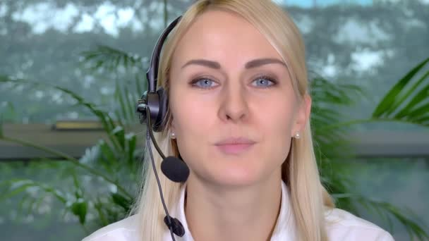 Call Center Employee is a stock video that consists of a close-up shot of a female call center employee working. She is talking into her headset.
