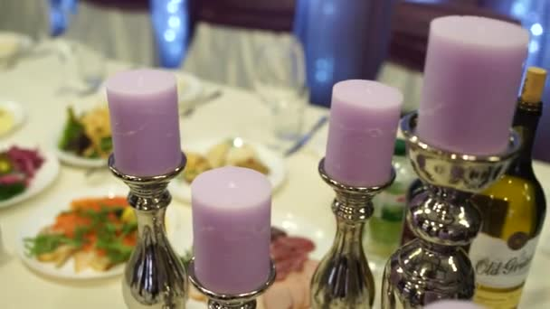 pink candles in a candlestick on a table in a restaurant