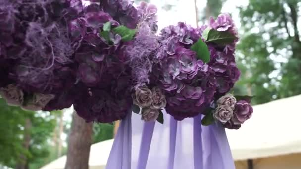 arch for a wedding ceremony of purple flowers