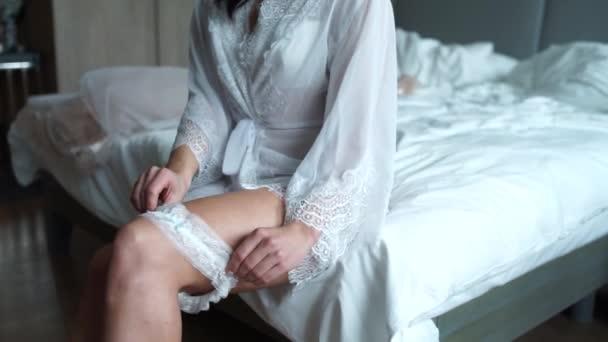 girl puts on a garter on her leg