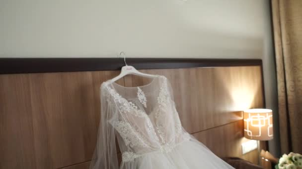 wedding dress on the bed in the room
