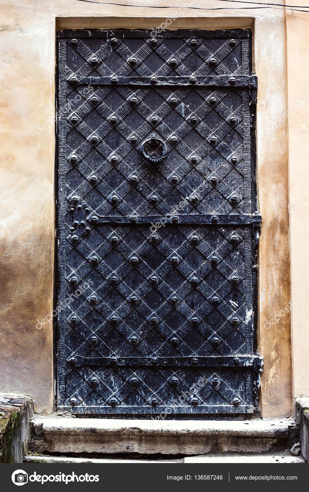 Old Steel Door : Antique vertical front door to the middle ages ancient