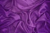 Fényképek Color trend 2018-ban, ultra lila selyem textúra