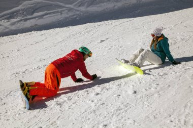 Russia, Sochi, December 01, 2017 - ski resort, instructor is teaching a young girl to ski, editorial.