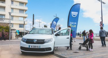 young man watching a car in Dacia Tour 2017