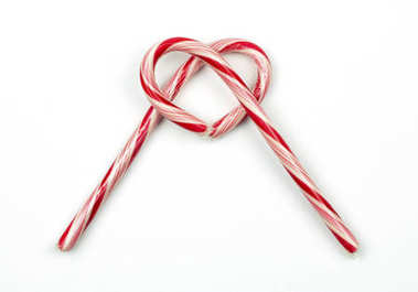 Two candy canes laying and overlapping