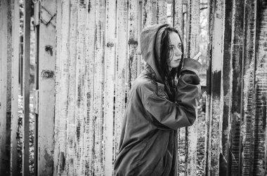 homeless beggar stilzhizni, health, social kontsept- tired, miserable homeless hungry man standing at the iron gates