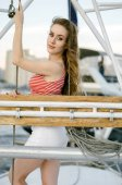 An attractive woman on a yacht on a summer day. Cruise, travel, tourist, regatta