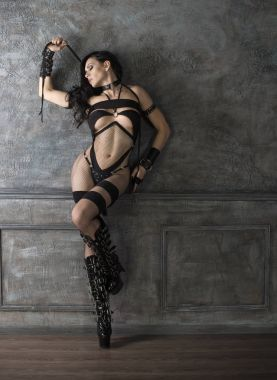 bdsm woman with whip on high heels