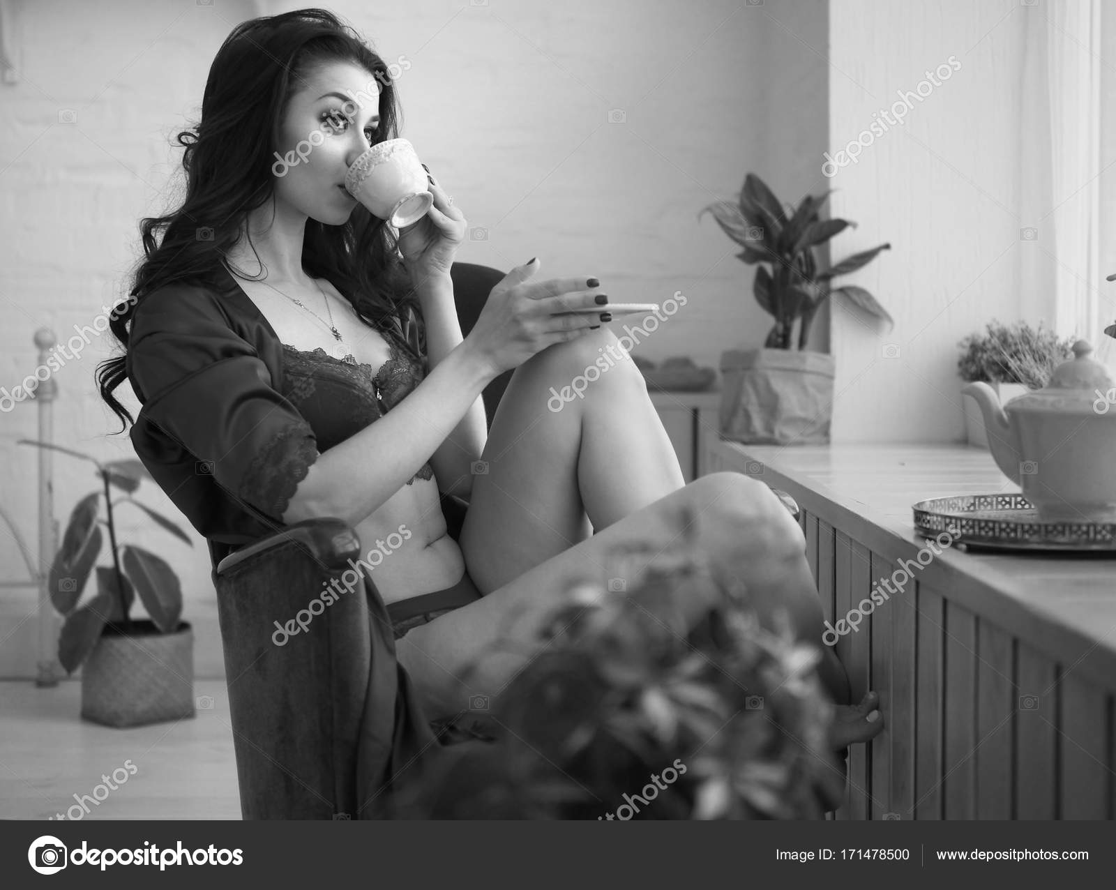 cf35d1e25 Sensual woman in sexy lingerie drinks coffe early in the morning in  terrace. Black and white picture. Old hollywood style.
