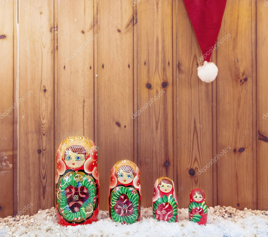 set of matryoshka covered by christmas hat warm look filtered