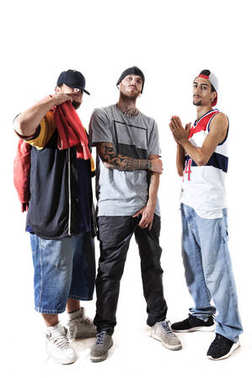 group of three rappers posing in the photographic studio