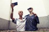 Fotografie pair of dummies take a selfie dressed in seventies sportswear cl