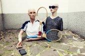 Fotografie pair of dummies take a selfie dressed in seventies tennis clothe