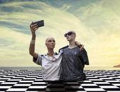 Fotografie pair of dummies take a selfie dressed in seventies sportswear