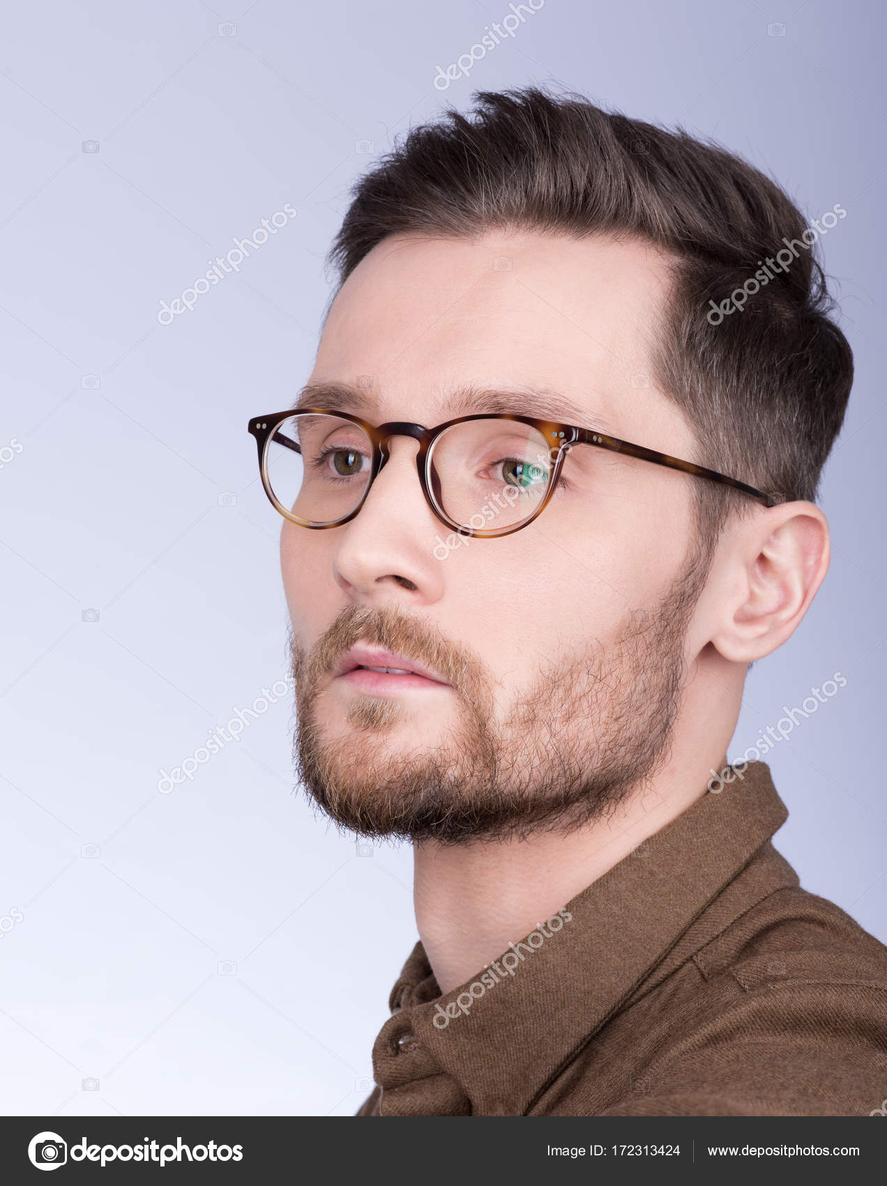 3b5766aad8f8 Fashion portrait of young attractive modern man. The beard and glasses —  Stock Photo