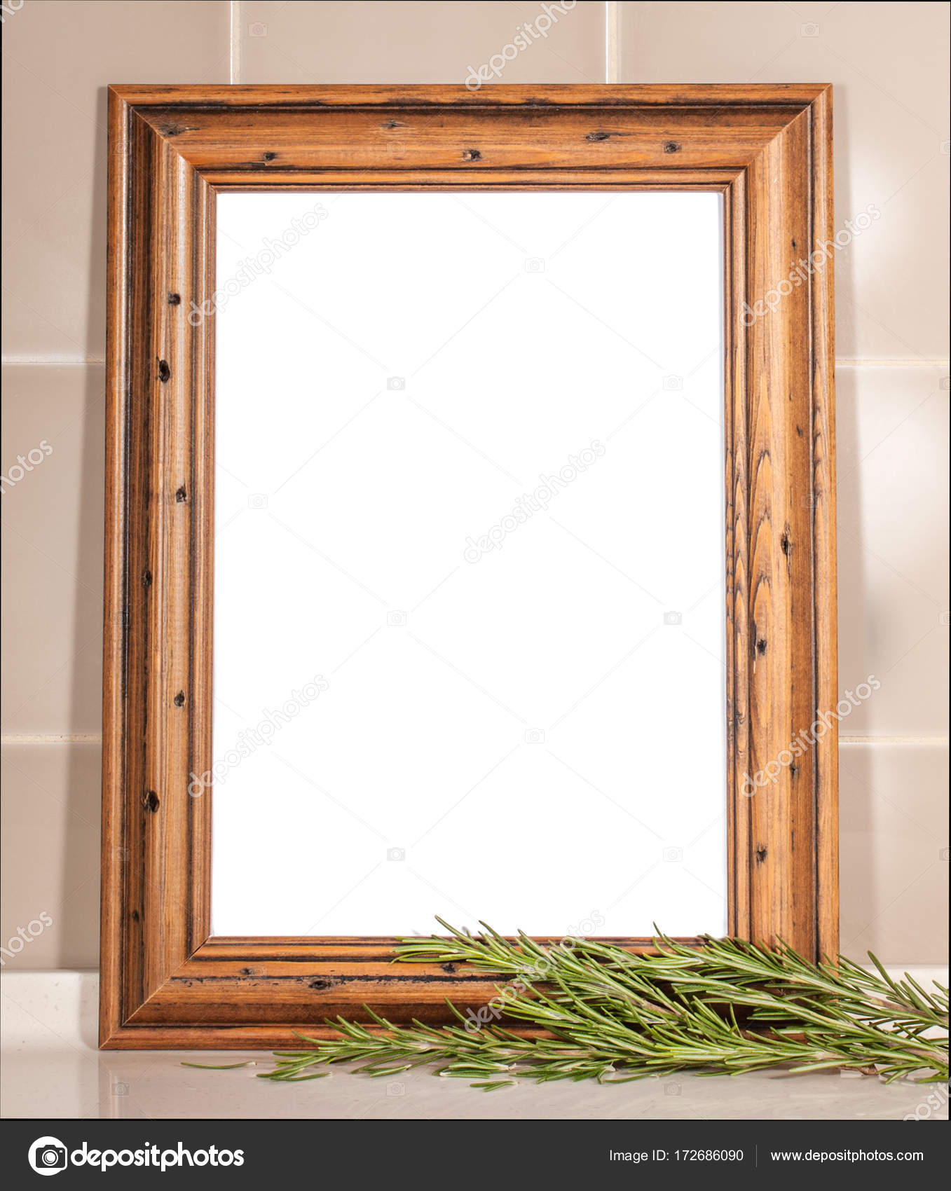 A white sheet menu in a wooden frame. The sprig of rosemary in the ...