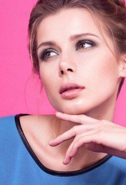 Dreamy eyes. Romantic beauty closeup portrait of beautiful young woman in blue sweater