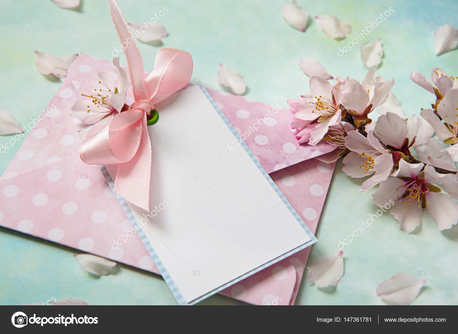 Blank card among almond flowers on light blue background — Stock ...