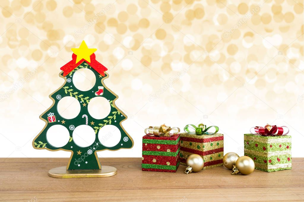 christmas tree golden balls and gift boxes with lights snow winter background photo by kosonphotogmailcom