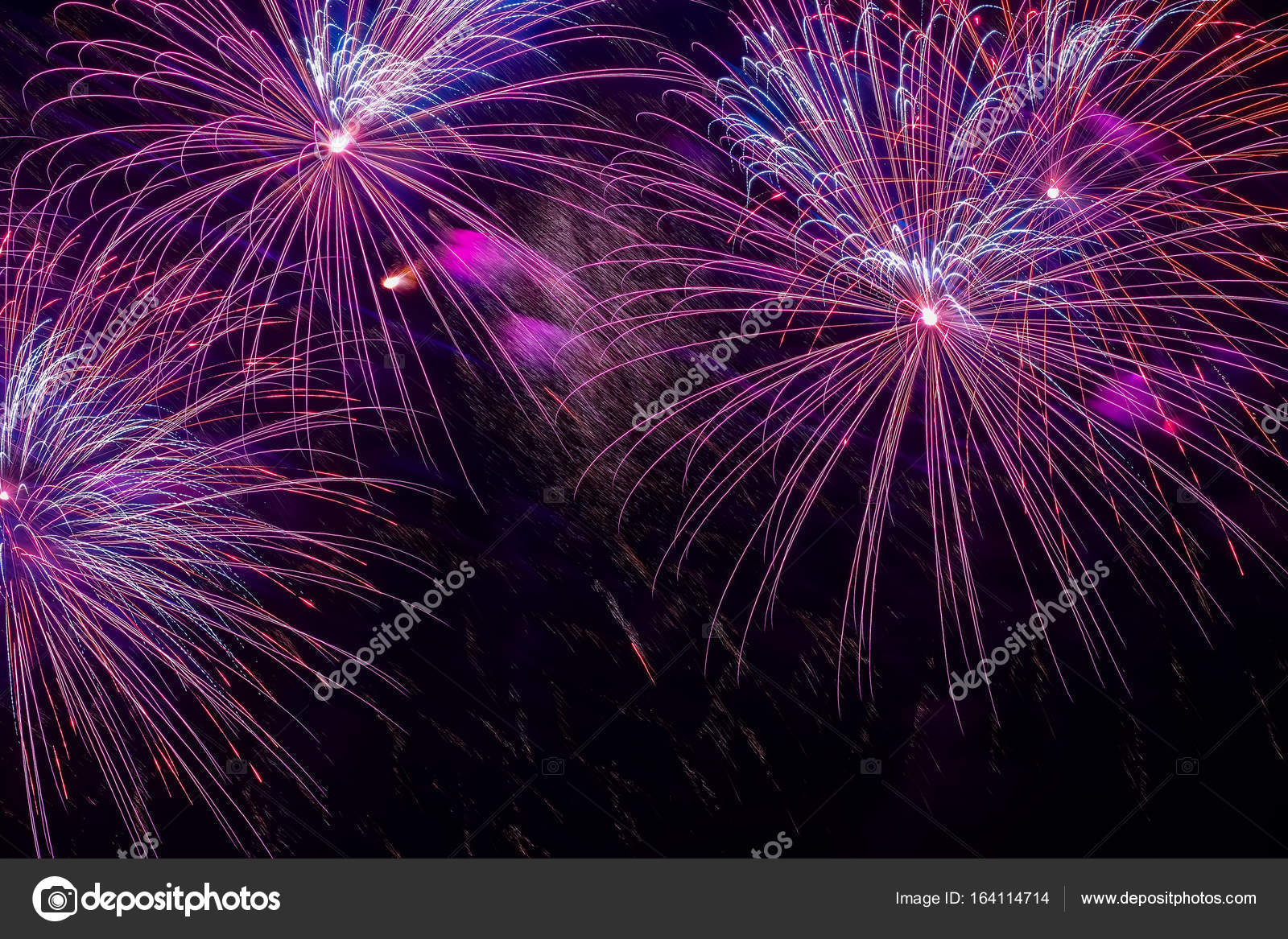 Close Up Of Vivid Purple Fireworks With Sparks Explosive